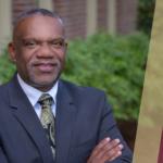 Dr. Gregory J. Harris posing in front of the Sandels Building