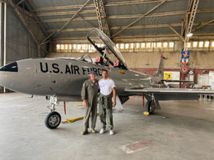 Suresh and Retired Air Force General posing in front of a T33
